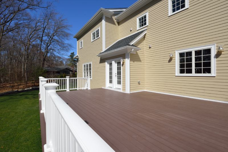 view of a big deck outside a house
