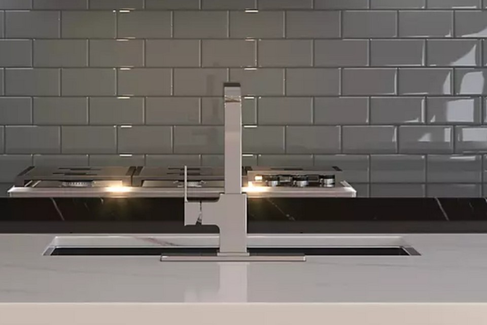 view of a tap in front of stove